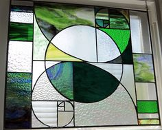 "18"" x 21""stained glass panel by 'joehasa' on Tumblr.  Bars on the sides are sized to represent the Fibonacci sequence: 1, 1, 2, 3, 5, 8."