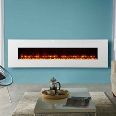 Gazco Radiance Glass Electric Fire The reflective solid Glass frame makes a stylish addition to the Gazco Radiance wall mounted electric fire range Electric Fire And Surround, Inset Electric Fires, Wall Mounted Electric Fires, Beautiful Wall, Beautiful Homes, Wall Fires, Living Room Decor, New Homes, Lounge