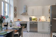 I love this kitchen! Scandinavian, modern and simple.