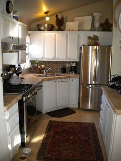 budget kitchen makeover- mobile home 700 dollars diy -wow