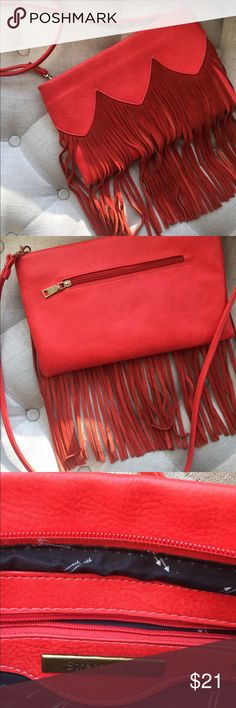 Street Level red/orange fringe crossbody or clutch This red/orange bag is perfect for a festival or a festive night out. Great pockets on the inside with removable strap and gold hardware. You'll love it! Brand new, no tags. street level Bags Crossbody Bags