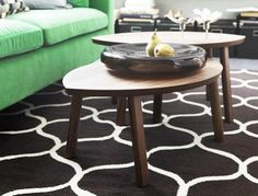 Ikea Stockholm 2013 collection: green velvet sofa, new rug and walnut veneer tables.