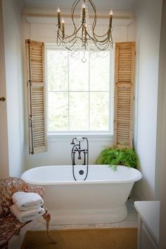 old-fashioned bathroom with shutters and deep tub. But I want the REAL old tub, like the ones it takes 3 men to carry!!