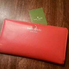 Kate Spade Tudor City Stacy Wallet Gently loved Kate Spade Tudor City Stacy Wallet. Very bright orange and pink. It does show some wear as it was my favorite.  Please see pics. Lots of life left on this beauty! kate spade Bags Wallets