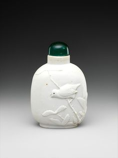 Snuff bottle with bird on a branch Period:Qing dynasty (1644–1911) Date:19th century Culture:China Medium:Porcelain with green glass stopper