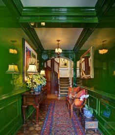 High gloss green on the walls from Fine Paints of Europe in the lesser seen half of an often seen foyer by Miles Redd.