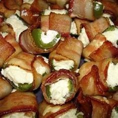 Bacon-Wrapped Jalapeno Poppers Huge site for game day appetizers food-drinks