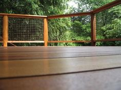 Cool Backyard Deck with Wire Grid Railing. Follow the link for tips on making your deck last for years.
