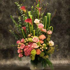 Extravagant arrangement of roses and calla lilies