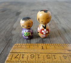 Teeny, tiny little Kokeshi dolls ready to come to you. These are hand painted in a lovely style that only the Japanese can do. Both of these