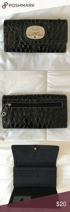 Kathy Van Zeeland Wallet Like new condition Kathy Van Zeeland Wallet. It's black with gold detailing throughout. No defects. Kathy Van Zeeland Bags Wallets