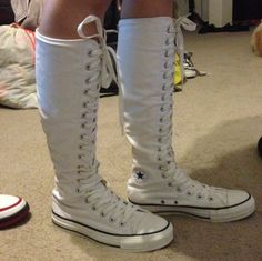 One of my pair of white knee high converse