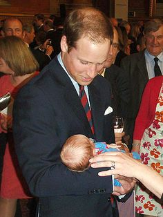 Prince William cuddles a newborn baby! Read more: http://www.people.com/people/package/article/0,,20395222_20590704,00.html
