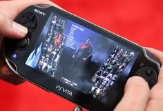 Here's an early look at Injustice: Gods Among Us Ultimate Edition running on the PS Vita.