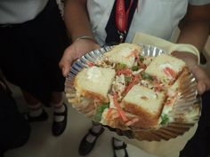 Culinary Club IV to VIII  Sandwich Recipe: Ingredients: Cabbage and capsicum chopped, mayonaise, oregano, chilli flakes, 4 slice of bread and salt. Methods Take one bowl and add chopped cabbage and capsicum. Then add some mayonnaise, oregano, chilli flakes and salt. Mix it well. Take one slice of bread and spread the mixture on it. Do the same on another slice and make the sandwich, cut it into two triangles and serve.  -at Rainbow International School Thane