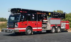 Rosenbauer—Michigan City (IN) Fire Department, 115-foot T Rex articulating aerial ladder platform quint.