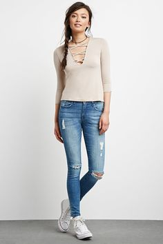 (24) A pair of denim woven skinny jeans with a five-pocket construction, mid-rise waist, zip fly.
