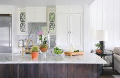 The combination of the reclaimed wood with the smooth stone countertop is just beautiful.