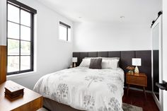 Bedroom by Madeleine Design Group, part of an award-winning Luxury Laneway home renovation in Vancouver, BC.
