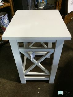 "This small white accent table would be a great addition in a small area where you need a floral or lamp. It's neutral color makes it perfect for any room and if you want a pop of color, it would be super easy to paint! Dimensions are 13-1/2"" x 15-1/2"" x 21""."