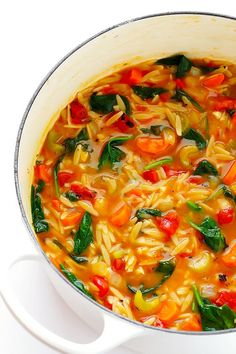This Italian Orzo Spinach Soup recipe is ready to go in 30 minutes, and it's so delicious and comforting! Feel free to add in some Italian sausage if you'd like extra protein.   gimmesomeoven.com