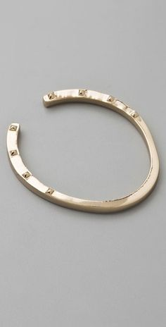 Horseshoe Bangle.  http://www.shopbop.com/horseshoe-bangle-house-harlow-1960/vp/v=1/845524441862305.htm?folderID=2534374302024617&fm=other-shopbysize-viewall&colorId=11739