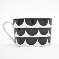 House of Rym 'Just My Cup of Tea' Scallop Cup: We love how well these monochrome cups and saucers mix and match! The cups are a good size, so can be used as a delicate coffee mug, or pair them with a mismatched saucer if you prefer.  Designed by: Anna Backlund  Dishwasher safe.  Packed in eco-friendly gift box.