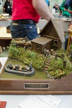 This diorama is amazing...the realism and detail unsurpassed! Moson Show 2013 Dioramas & Vignettes | Modelhobby.eu Village Miniature, Train Miniature, Miniature Houses, Plastic Art, Plastic Models, Military Diorama, Military Modelling, Tiny World, Scale Models