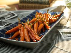 Honey-Roasted Carrots with Sesame Seeds recipe from Food Network Specials via Food Network Sesame Seeds Recipes, Carrot Recipes, Vegetable Recipes, Cooking Channel Recipes, Honey Roasted Carrots, Glazed Carrots, Best Thanksgiving Side Dishes, Thanksgiving 2017, Vegetable Side Dishes