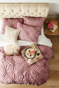 Breakfast in bed is always a good idea, but especially with Pier 1's ruched Savannah bedding in deep lilac. It gathers fresh 100% cotton in a pattern of flowers on a field of diamonds. Inside ties at all four corners keep your duvet from shifting, while shams feature tie backs and decorative welting.