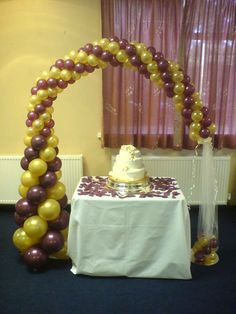 white and gold baloon arch | lovely wedding reception in Pearl Burgundy and Gold