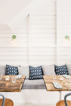Booth style seating for kitchen. Hally's Parsons Green, white shiplap, blue and white ikat and striped ticking Decor, Home, House Design, Cafe Interior, Interior Design, Restaurant Interior, House Interior, Ship Lap Walls, White Shiplap