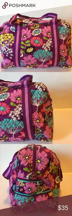 Vera Bradley Flutterby Pattern Duffel Bag Vera Bradley Flutterby Pattern Duffel Bag  Fresh cut wildflower bouquets mingle with whimsical butterflies for the Flutterby pattern  Two strapped handles  Pocket on one side of the bag  Mesh pockets on the inside  Spacious overnight bag                                                                 never used  Meas