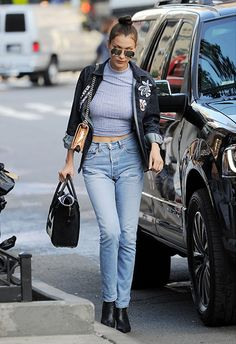 Bella Hadid wearing mom jeans with an embroidered shirt | ASOS Fashion & Beauty Feed