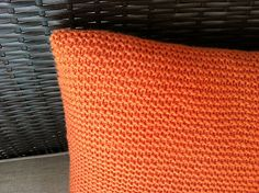 "Simple Knit Pillow by Brittany Coughlin   My knitted garter stitch fabric measures 23 1/2 inches long by 14 inches wide before folded in half. Once seamed up, can stretch over a 16"" x 16"" pillow form."