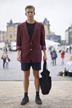 Street Style from Coppenhagen. Love the oversized look of the blazer teamed with the shorts! Very simple, but cool.
