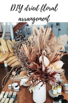 How to make a dried floral arrangement Structural dried flowers and foliage add visual interest and they last forever. Here's how to make your own arrangement. How to make a dried floral arrangement Diy Dried Flower Arrangement, Dried Flower Bouquet, Silk Flower Arrangements, Flower Centerpieces, Flower Bouquet Wedding, Dried Flowers, Flower Decorations, Silk Flowers, How To Dry Flowers