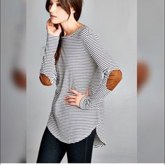 HPLongSleeve Patch Tunic Semi loose tunic. Faux suede elbow patch. Navy and white striped knit. Fabric is made of cotton, polyester, rayon and spandex.                         Available in Small Medium and Large.                        Comment below for your bundle listing Gin Tops Tees - Long Sleeve
