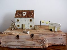 Beyond the Cowshed  Little wooden driftwood house and caravan