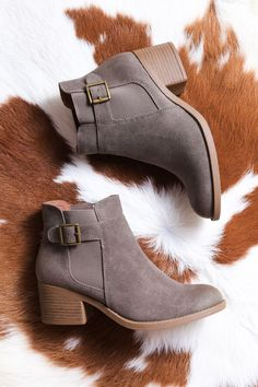 Featuring a nubuck leather look and faux wood heel, this beauty will be a staple in your wardrobe. Wear with dresses, skinnies, skirts, you name it! View More Colors GENERAL INFO: - Man made materials
