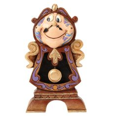 Celebrate the 25th anniversary of Beauty and the Beast with this figurine. Jim Shore brings his unmistakable folk art style to this delightful design featuring Cogsworth, the officious butler with the heart of gold.