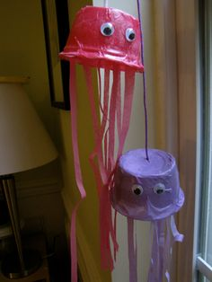 Paper mache project with empty applesauce cups. Super cute jelly fish! I dont know that I'd use these in bathroom but good idea anyway.