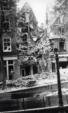 October A British bomb hit a house at the Rechtboomsloot in Amsterdam in the night of Sunday The British bombing raids, targeted at German military facilities, often missed their targets and caused many civilian casualties. Pin by Paolo Marzioli Amsterdam City Centre, I Amsterdam, London Bombings, Operation Market Garden, Bataan, The Blitz, Battle Of Britain, Anne Frank, History Photos