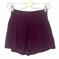 Lululemon maroon shorts size 4 Beautiful maroon shorts, like new! Black details. Black logo on hem. Very clean. lululemon athletica Shorts Skorts