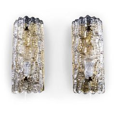 Pair of Orrefors wall sconces in glass and brass.