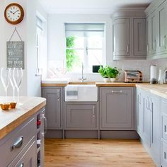 We love this country kitchen with grey painted cabinetry and wooden worktops - a classic combination that will forever be stylish Looking for kitchen decorating ideas? Take a peek at this country kitchen with grey painted cabinetry and wooden worktops Grey Shaker Kitchen, Grey Kitchen Cabinets, Wooden Kitchen Countertops, Wooden Kitchens, Painting Kitchen Cupboards, Belfast Sink Kitchen, Warm Grey Kitchen, Light Grey Kitchens, Painted Cupboards