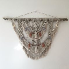 Driftwood macramé wall hanging with coloured thread. Rose gold, silver and beige