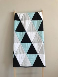 For a girl use pink, grey, and peach, or chocolate brown. Blue Crib, Baby Blue, Triangle Quilt Pattern, Triangle Quilts, Triangles, History Of Quilting, Quilting 101, Quilting Ideas, Quilting Projects