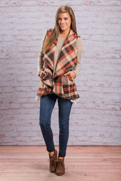 This plaid vest is must have for this fall/winter! It's so classic! This orange and brown vest will layer beautifully over so many tops, tunics and dresses this fall and winter! We love that it also has pockets to keep your hands warm!  Material has no amount of stretch. Miranda is wearing the small.