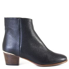 Just a little bit of flair enhances the Carter ankle boot from Emma Go. This classic boot is handmade in a black leather with a lighter sole for a more casual look. A sliver of gold is placed at the heel and gives Carter a subtle dash of pizzazz.   FREE Shipping in the contiguous USA Women's heeled ankle bootie Handmade in Spain Smooth black calfskin 100% leather upper, lining and footbed Leather sole with durable rubber protection 2 inch heel Inside zipper Brass detail at heel Fits true to…
